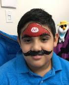 Full face painting done by a qualified artist at your child's birthday party like this Super Mario Brothers painting.