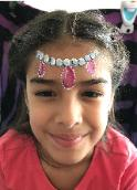 Houston full face painting at your child's birthday party with an example of this beautiful tiara with jewels and gems.