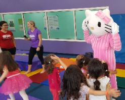 Little Gym birthday parties can be even more fun with a a mascot costumed character like this kitty.