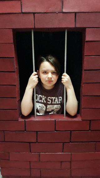 This super cool jail cell prop is available for your little heroes birthday party in Houston.