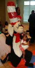 The cat in the hat mascot costumed character birthday party in Sugarland, texas.