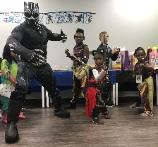 This is an A+ picture with some dedicated heroes with this superhero for Houston area birthday parties.