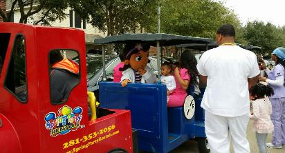 Doc mcstiffins mascot birthday party train ride in tomball, texas.