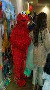 Elmo from sesame street for rental in sugarland, texas for a mascot party.