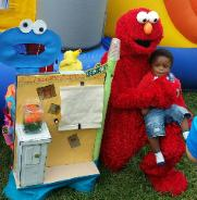 Rent Elmo mascot costumed character for birthday party in Katy, Texas.