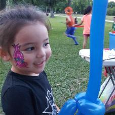 Rent an artist to do face painting and balloon animals at your next houston birthday party. This little girl in Jersey Village had a Poopy Troll painted and a balloon sword made.