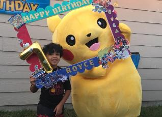 Pikachu mascot costumed character available to hire for birthday parties in Houston, Texas.