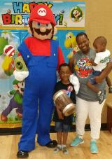 Mario mascot costumed character in Kingwood, Texas for a birthday party at lifetime fitness.
