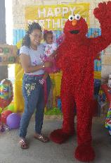 Hire a mascot costumed character for your sesame street elmo birthday party in Houston, Texas.