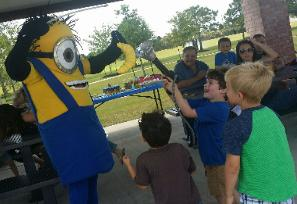 Minion mascot at a birtyhday party in richmond, texas for rent.