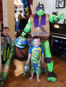 Hire a Donatello Ninja Turtle superhero mascot costumed character for a birthday party in Houston, Texas.